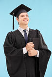 Proud graduate student holding a book Stock Photography