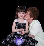 Proud grand-mother kissing grand-daughter Royalty Free Stock Images