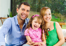 Proud happy hispanic parents posing with little Stock Images