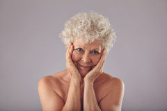 Proud of her skin condition at old age Stock Photos