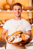 Proud of his baked goods. stock photos