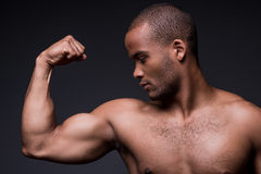 Proud of his perfect biceps. Royalty Free Stock Photos