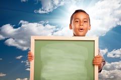 Proud Hispanic Boy Holding Blank Chalkboard Over S stock photos