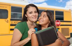Proud Hispanic Mother and Daughter Near School Bus royalty free stock photography