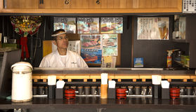 Proud japanese man in his restaurant Stock Image