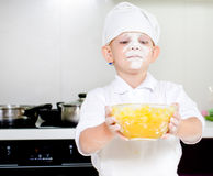Proud little boy chef with a face full of flour Royalty Free Stock Photography