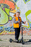 Proud little boy with his scooter Stock Images