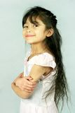 Proud little girl arms crossed Stock Photo