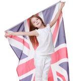 Proud little girl holding UK flag Stock Images