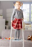 Proud little girl on top of ladder at home Stock Image