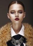 Arrogance. Stately Luxurious Woman in Wool Collar and Necklace. Proud & Luxurious Woman in Woolen Collar and Necklace royalty free stock image