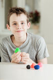 Proud male child working with colorful clay Royalty Free Stock Photo