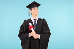 Proud male graduate student holding a diploma Royalty Free Stock Photography