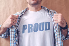 Proud man. Guy revealing his shirt with proud title, pride and arrogance concept Royalty Free Stock Photo