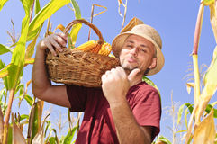Proud man with maize basket Royalty Free Stock Photo