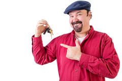 Proud man pointing to his new car keys Stock Images