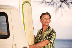 Proud Man with Surfboard Stock Photos