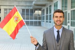 Proud man waving the Spanish flag Royalty Free Stock Photography
