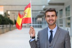 Proud man waving the Spanish flag Stock Photography