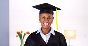 Proud mature African woman graduate Royalty Free Stock Photo