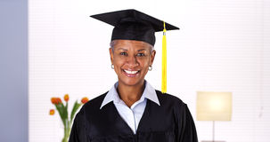 Proud mature African woman graduate Royalty Free Stock Photos