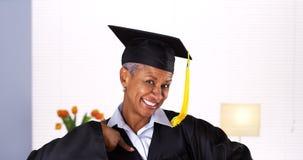 Proud mature African woman graduate Stock Image