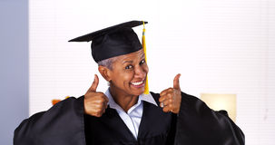 Proud mature African woman graduate Royalty Free Stock Image