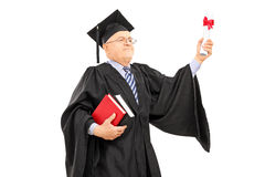 Proud mature student holding a diploma Royalty Free Stock Photography