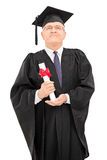Proud mature student holding his diploma Royalty Free Stock Images
