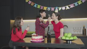 Proud mom congratulating daughter with Birthday. Happy mother proud of adult beautiful child toasting, wishing happiness, drinking on brotherhood with daughter stock video
