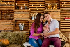 Proud mother and father smiling at their newborn baby daughter at studio stock photography