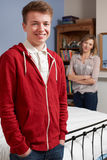 Proud Mother With Teenage Son At Home Stock Photo