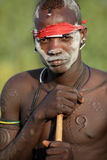 Proud Mursi warrior at a ceremony in South Omo, Ethiopia Royalty Free Stock Photo