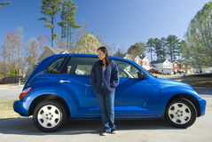 Proud of my car. Picture of a girl showing off her car by posing in front of it Stock Photos