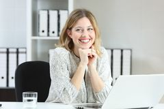 Proud office worker posing looking at side Stock Photo