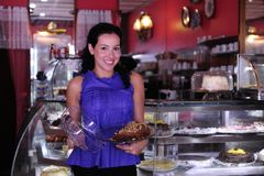 Proud owner of a cafe/ pastry shop. Proud and confident owner of a cafe/ pastry shop stock image