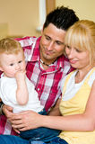 Proud parents. Portrait of young parents proud of their baby son stock image