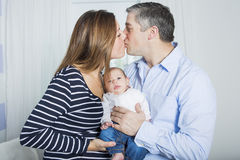 Proud Parents Holding Baby in the bedroom Stock Photography