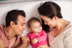 Proud parents looking at their baby daughter Royalty Free Stock Images
