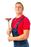 Proud plumber with a rubber plunger Stock Photography