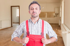 Proud plumber sitting in the house royalty free stock image