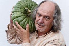 Proud pumpkin grower Royalty Free Stock Photography