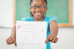 Proud pupil showing test result to camera Stock Photo