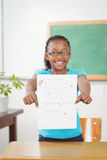 Proud pupil showing test result to camera Stock Photos