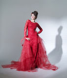 Proud red queen in fashion pose Stock Photo