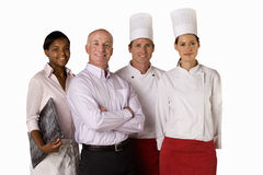 Proud restaurant manager with waitress and chefs, smiling, portrait, cut out Royalty Free Stock Photos