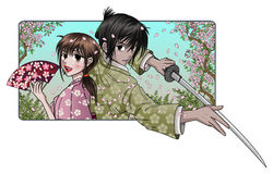 Proud Samurai and Fine Lady. Proud samurai holding blade and fine japanese lady holding a fan - infront of a sakura tree nature background Royalty Free Stock Photography