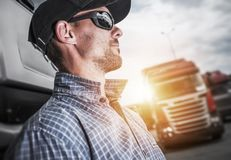 Proud Semi Truck Driver. Proud Caucasian Semi Truck Driver Portrait In Front of His Truck stock images