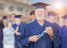 Proud Senior Adult Man In Cap and Gown At Outdoor Graduation Cer Royalty Free Stock Images