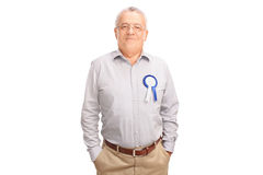 Proud senior posing with blue award ribbon. Proud senior gentleman posing with blue award ribbon on his shirt isolated on white background Stock Images